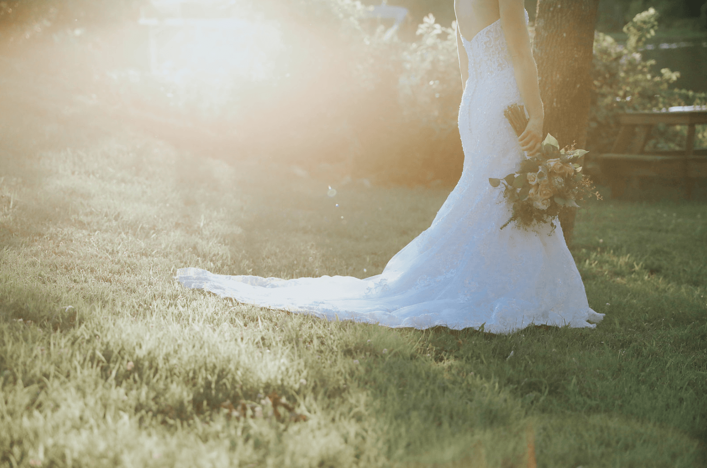 Bride posing in an open field