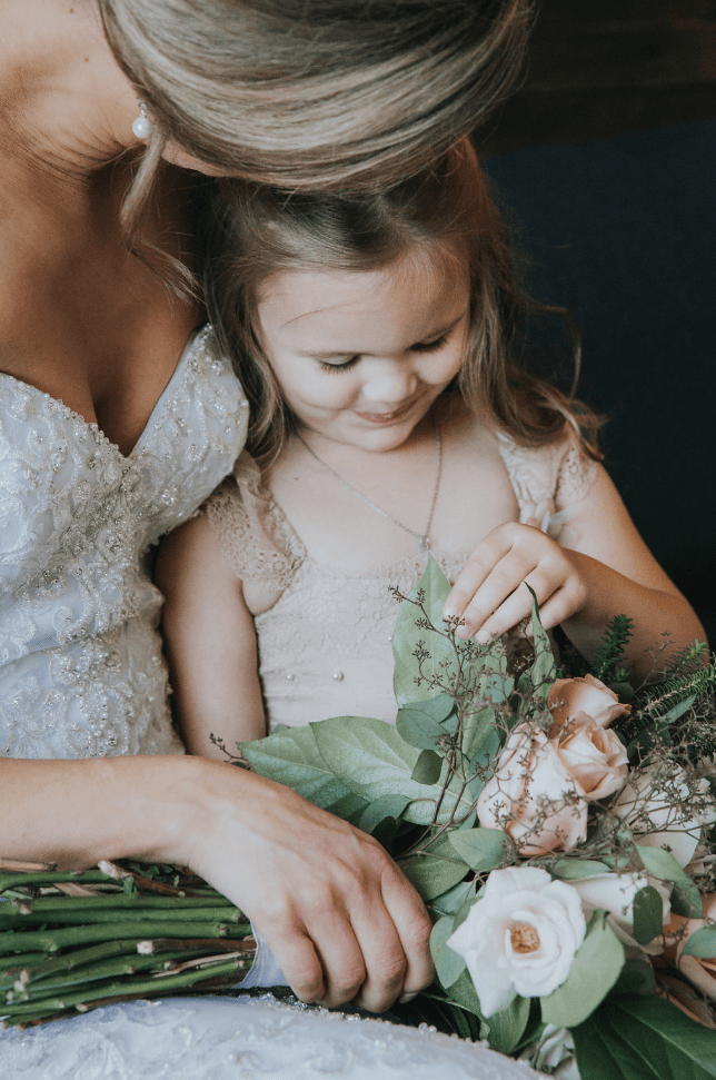 Bride and flower girl sitting