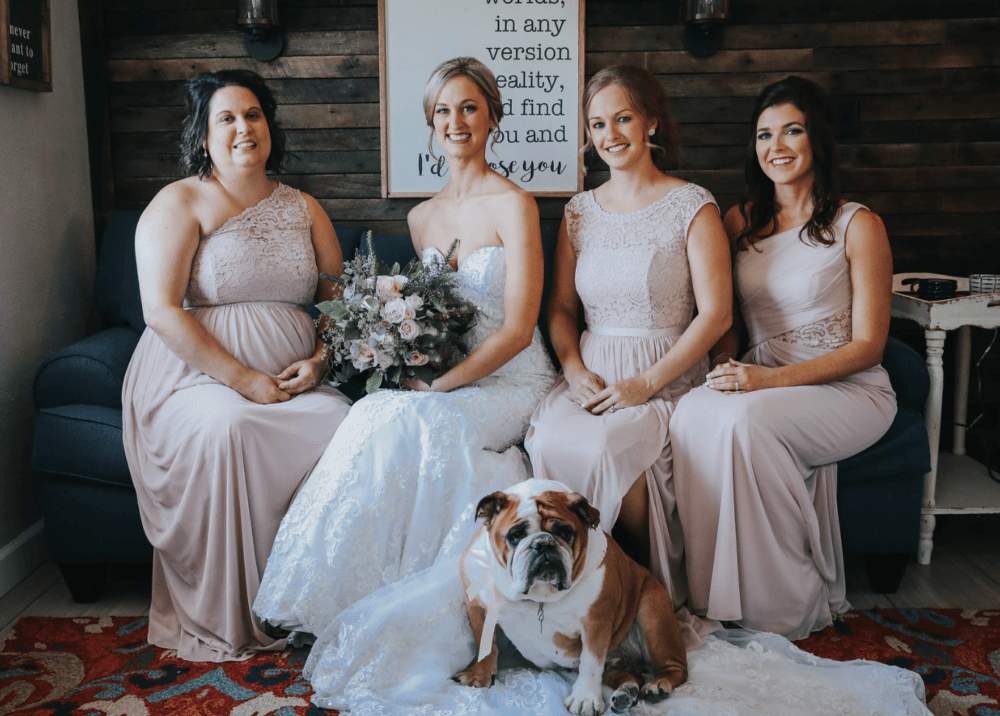 Bridal party posing inside lakeside bridal suite