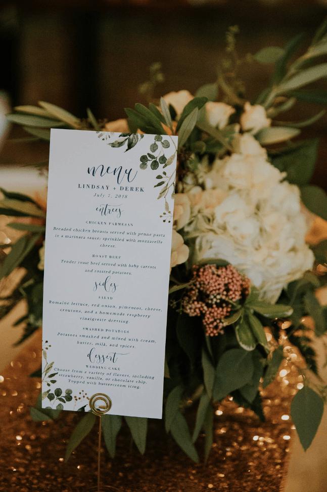 Wedding dinner menu sitting in flower bouquet